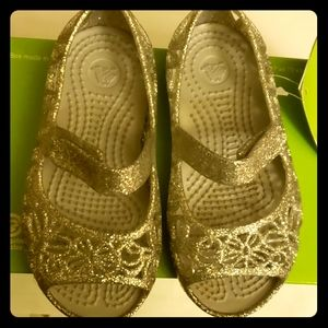 Silver Crocs Isabella glitter flat sandals